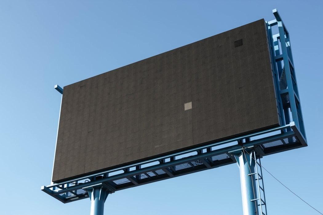 Plain black billboard with no advertisement on it.