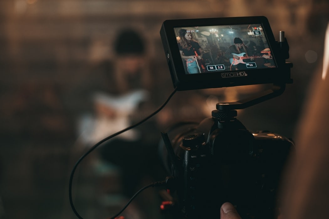 Close up of a camera monitor in a dimly lit room.